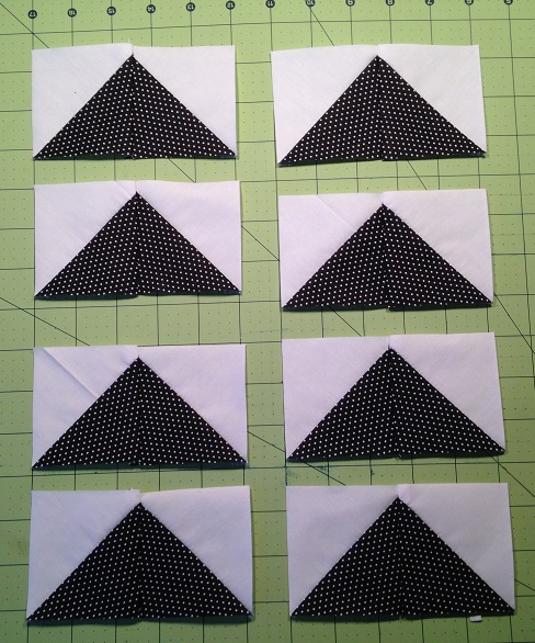 Half-square triangle jelly roll quilt challenge- Dutchman's Puzzle/Flying Geese!